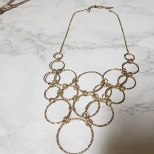 Gold necklace with gold hoops